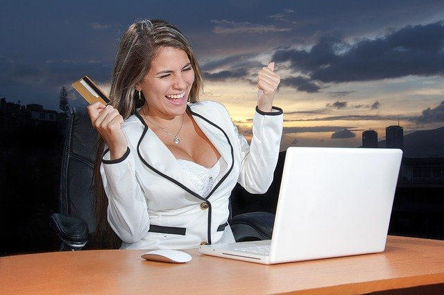 Woman making an online Payment smiling